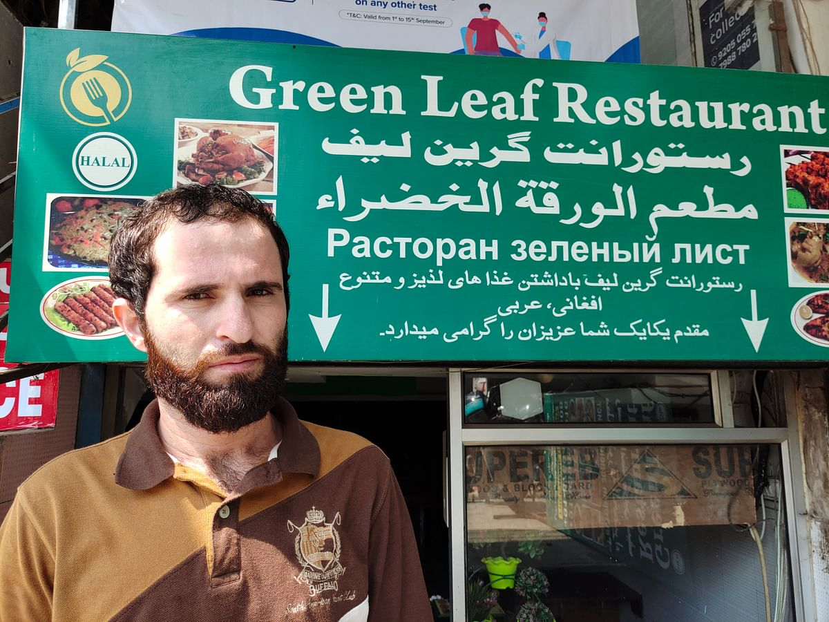 """<div class=""""paragraphs""""><p>Sikander Khan (26), Afghan refugee working at Green Leaf Restaurant in Hauz Rani. There are&nbsp;several  small eateries selling Afghan food here,  employing  refugees like Sikander.</p></div>"""