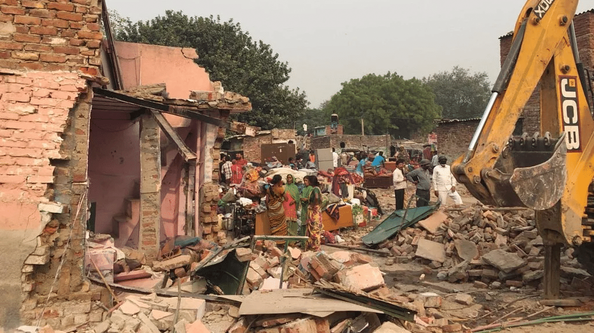 """<div class=""""paragraphs""""><p>File photo: Settlers of Kathputli Colony wait where their homes once stood, minutes after they were demolished by the Delhi Development Authority bulldozers on Monday, 30 October.</p></div>"""