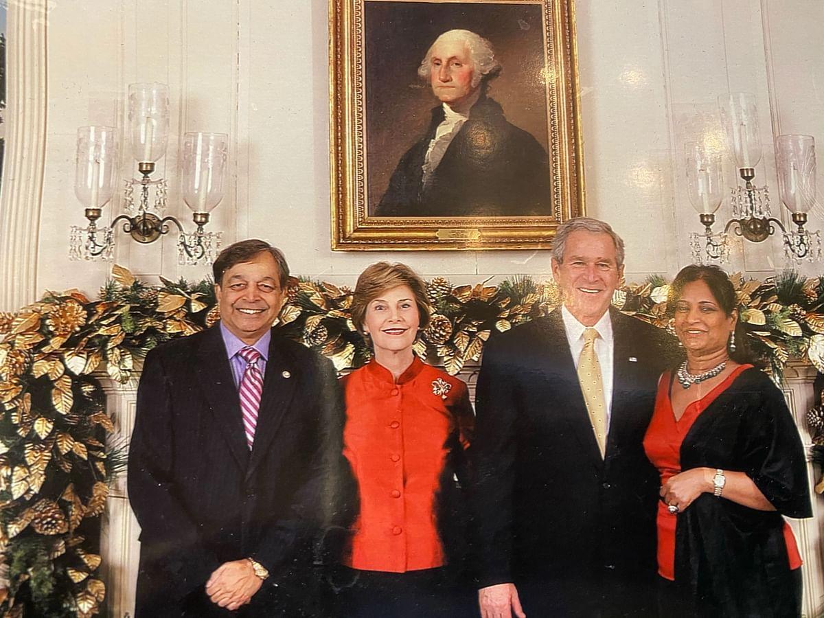 """<div class=""""paragraphs""""><p>Sampat Shivangi with George W. Bush.</p></div>"""