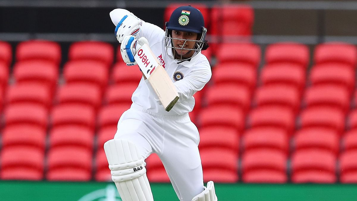 """<div class=""""paragraphs""""><p>Smriti Mandhana in action during the Pink Ball Test against Australia,</p></div>"""
