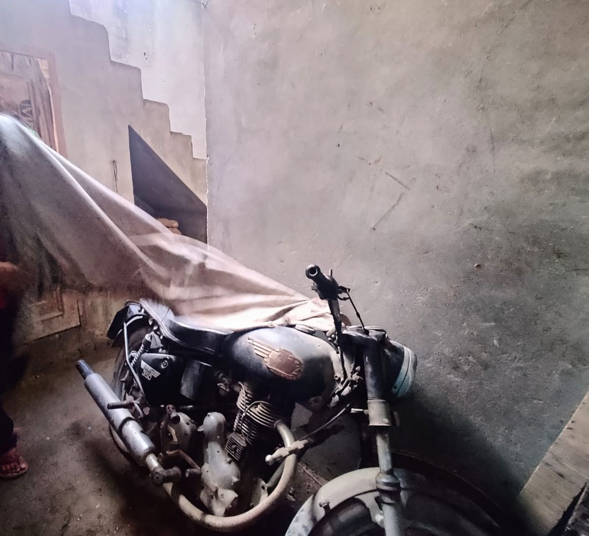 """<div class=""""paragraphs""""><p>This is Shahnawaz's motorbike that has been gathering dust for the last eight years.</p></div>"""