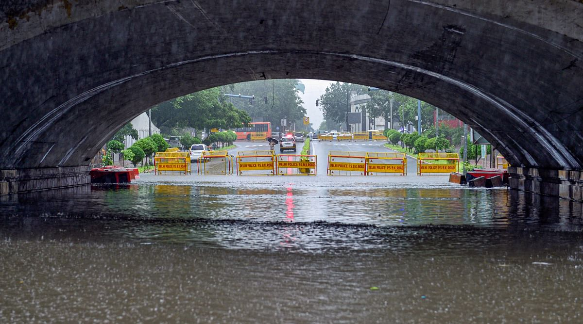 """<div class=""""paragraphs""""><p>New Delhi: Traffic stopped at Minto bridge due to heavy water logging after heavy rains in New Delhi, Wednesday.</p></div>"""