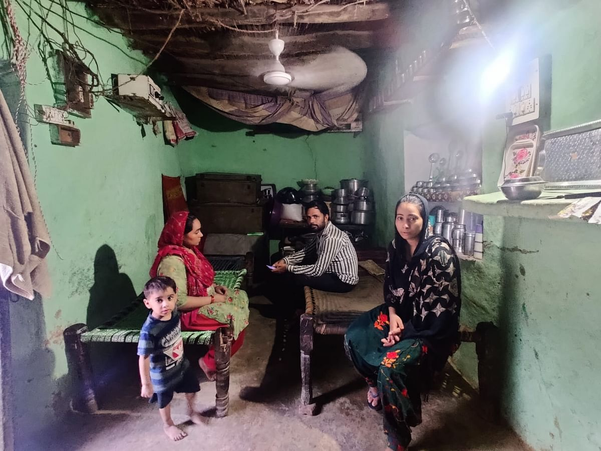 """<div class=""""paragraphs""""><p>Shahnawaz's sisters and cousins at their one-room home. They built another home adjacent to this that awaits complete construction.&nbsp;</p></div>"""