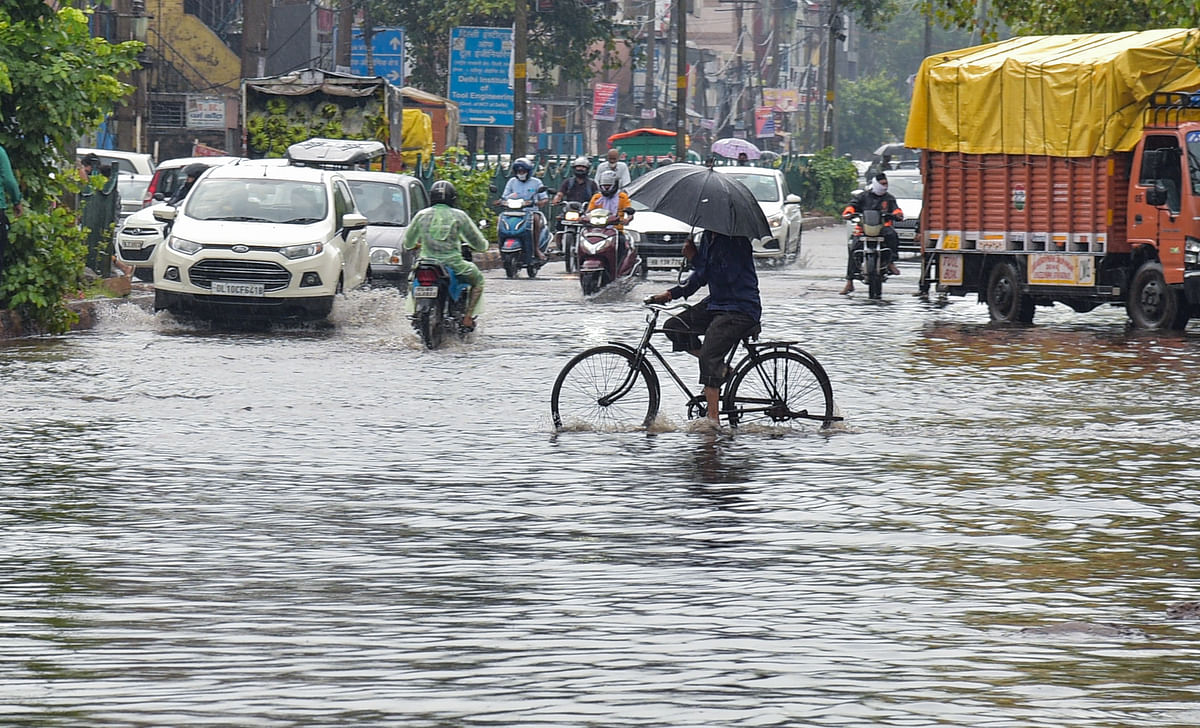 """<div class=""""paragraphs""""><p>New Delhi: Commuters wade through the waterlogged Ashok Vihar area after heavy rain in New Delhi, Wednesday, Sept. 1, 2021. Delhi on Wednesday recorded its highest rainfall in at least 12 years. </p></div>"""