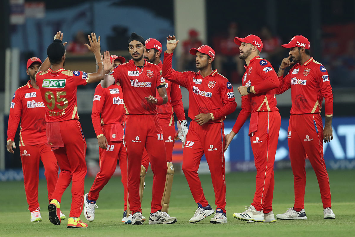 """<div class=""""paragraphs""""><p>Arshdeep Singh celebrates a wicket with his team-mates.</p></div>"""