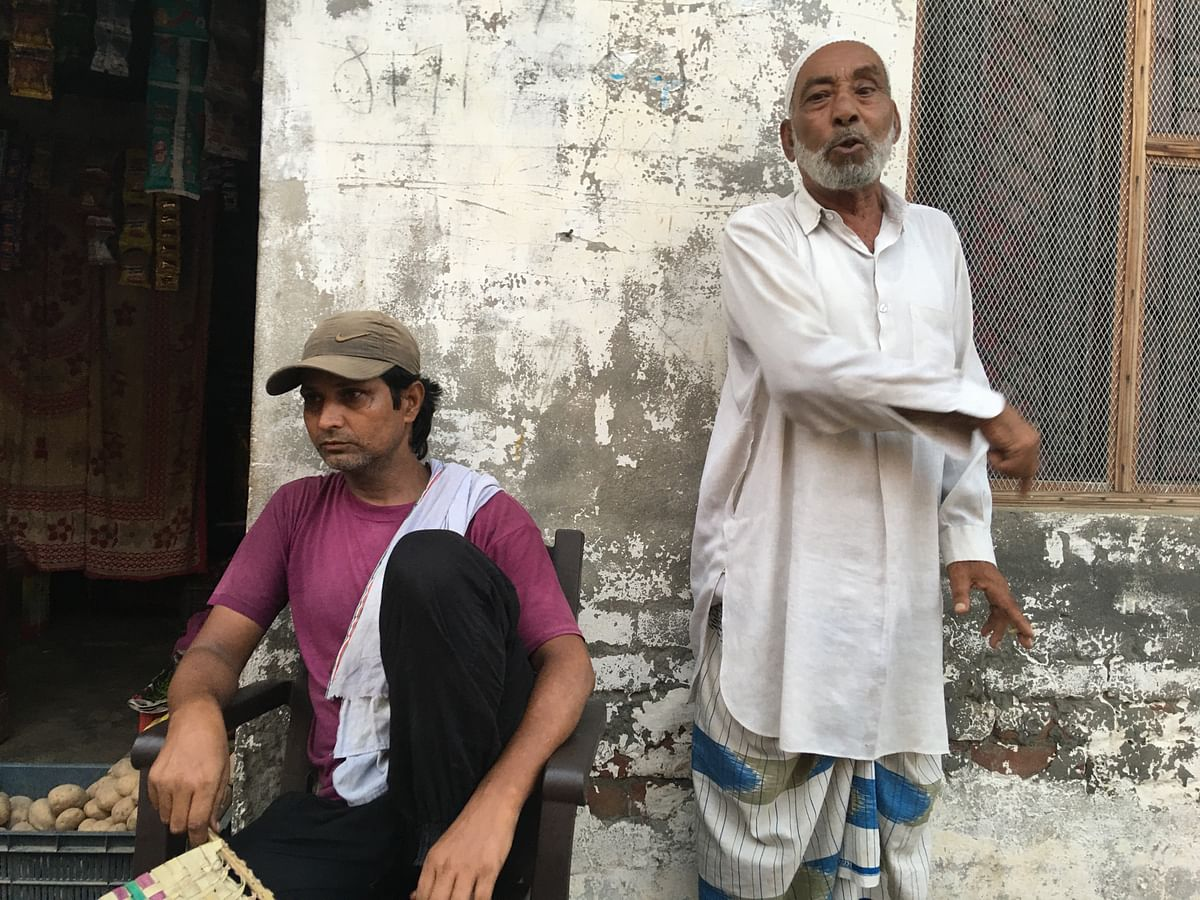 """<div class=""""paragraphs""""><p>Salim points to the exact spot he stood at while he saw his son being thrashed,</p></div>"""