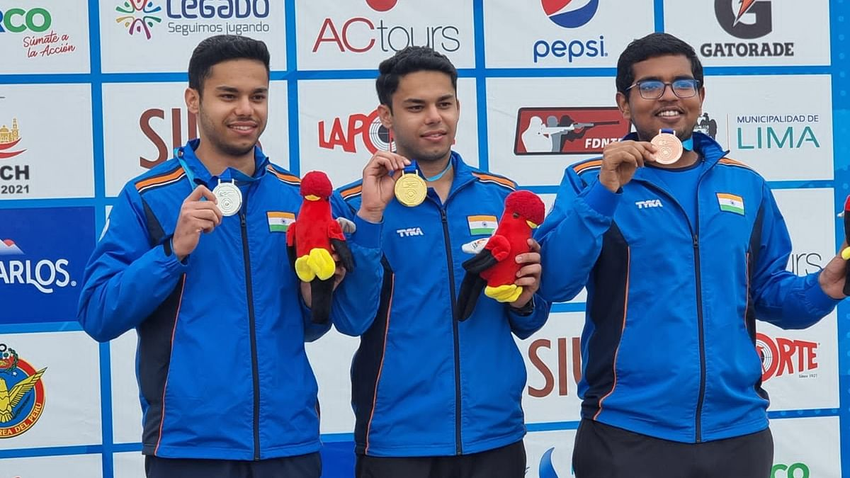 """<div class=""""paragraphs""""><p>Udhayveer Sidhu, Vijayveer Sidhu &amp; Harsh Gupta on the podium with their medals after the 25M Standard Pistol event at the Junior Shooting World Championship.</p></div>"""