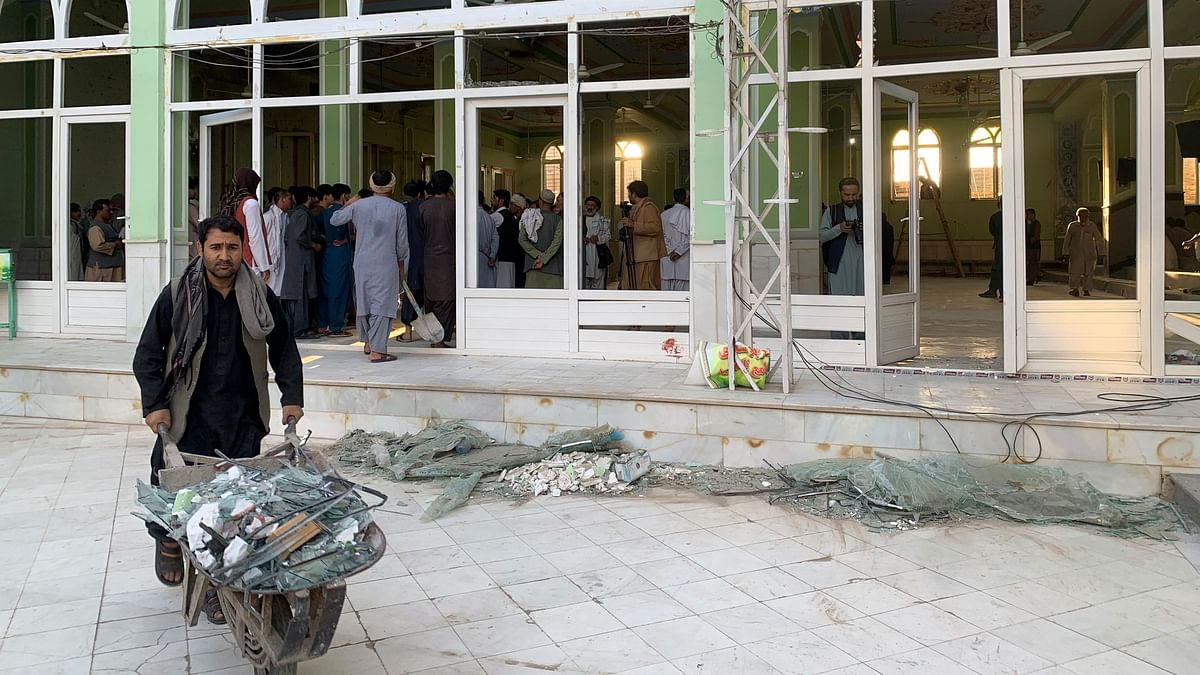"""<div class=""""paragraphs""""><p> People view the damage inside of a mosque following a suicide bombers attack in the city of Kandahar, southwest Afghanistan, Friday, 15 October.</p></div>"""