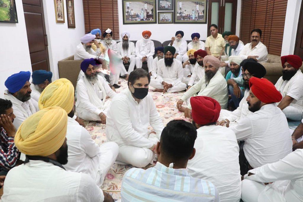 """<div class=""""paragraphs""""><p>Varun Gandhi meeting Sikh farmers from Pilibhit in September.&nbsp;</p></div>"""