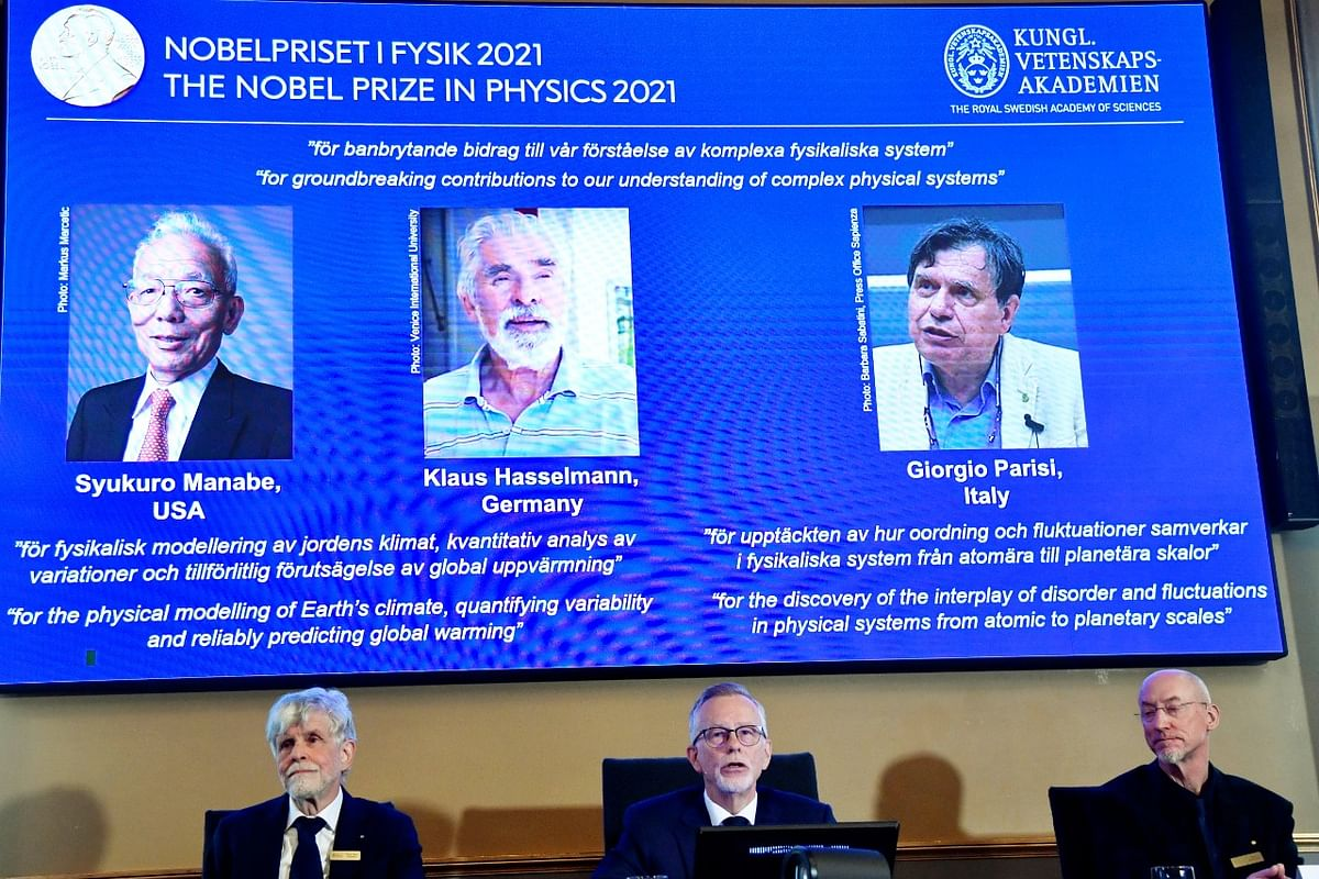 """<div class=""""paragraphs""""><p>Stockholm: Secretary General of the Royal Swedish Academy of Sciences Goran Hansson, center, flanked at left by member of the Nobel Committee for Physics Thors Hans Hansson, and member of the Nobel Committee for Physics John Wettlaufer, right, announces the winners of the 2021 Nobel Prize in Physics at the Royal Swedish Academy of Sciences, in Stockholm, Sweden</p></div>"""