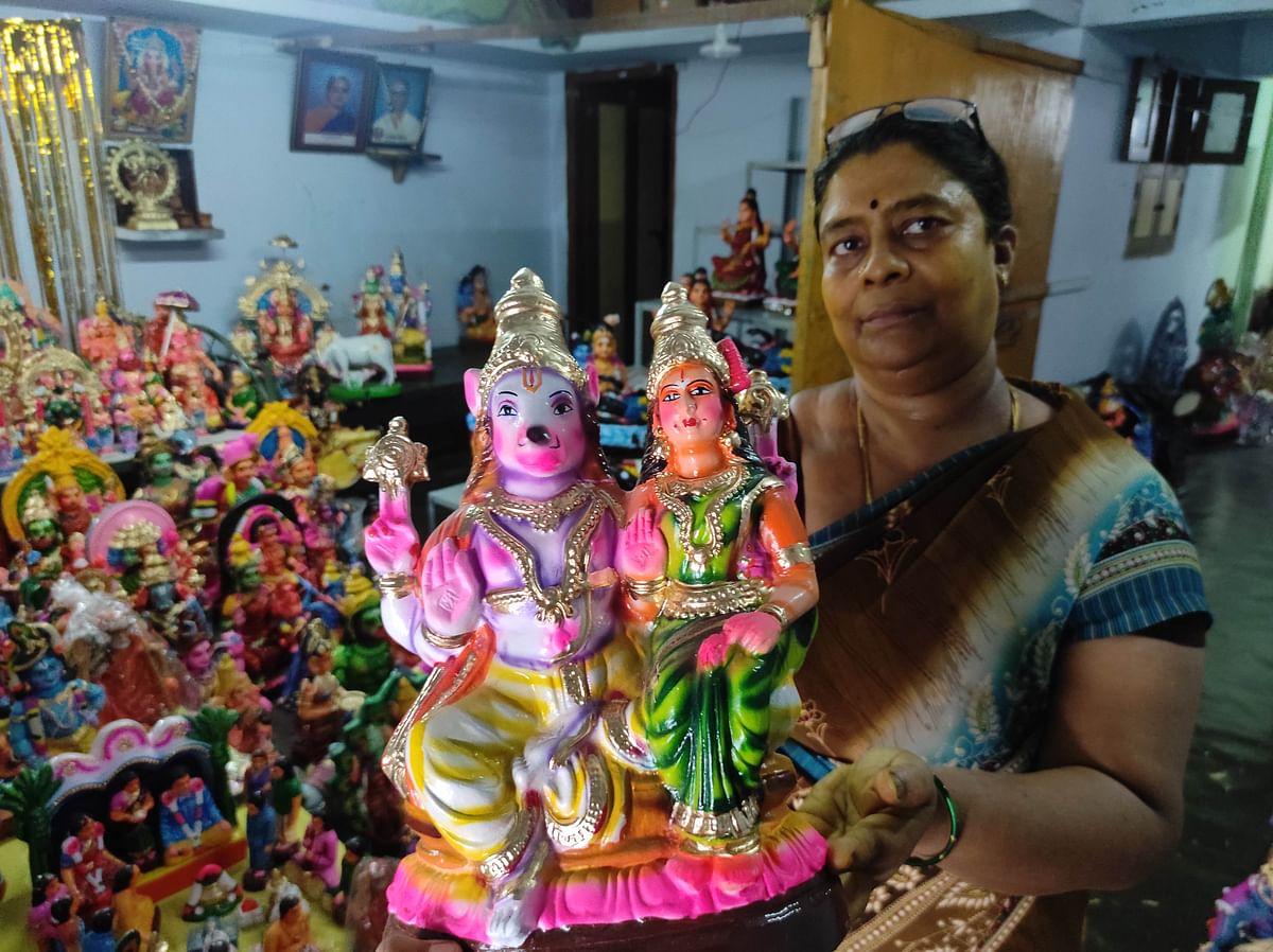"<div class=""paragraphs""><p>Doll maker Sivashankari shows a doll kept at their house.</p></div>"
