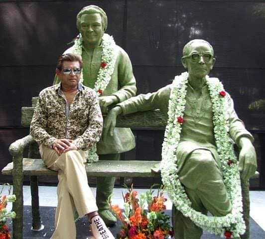 """<div class=""""paragraphs""""><p>Amit Kumar during the inauguration of the statue of Kishore Kumar and SD Burman near Golpark, Southern Avenue in Kolkata, in 2018.</p></div>"""