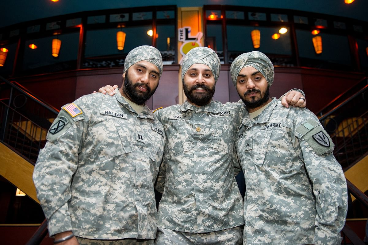 """<div class=""""paragraphs""""><p>Lt Col Kalsi with Capt Tejdeep Rattan, Corporal Simran Singh Lamba (right) granted religious articles of faith while serving in the US Army at a The Sikh Coalition event.</p></div>"""