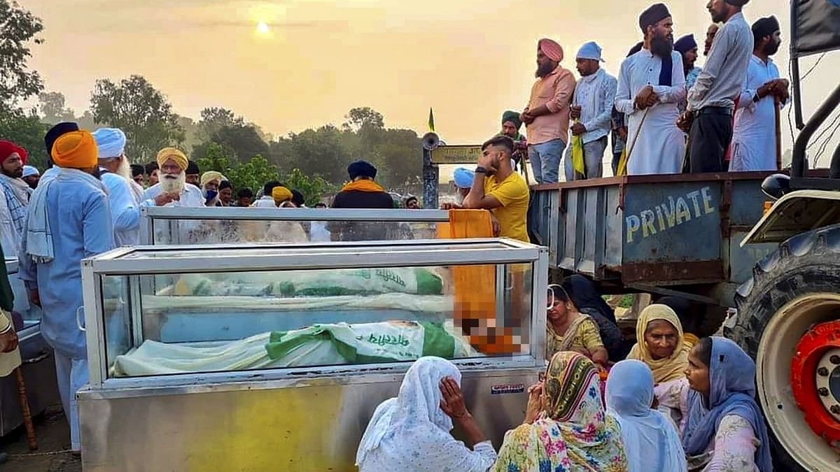 """<div class=""""paragraphs""""><p>Farmers with mortal remains of their family members who were killed in Sunday's violence in Lakhimpur Kheri.</p></div>"""