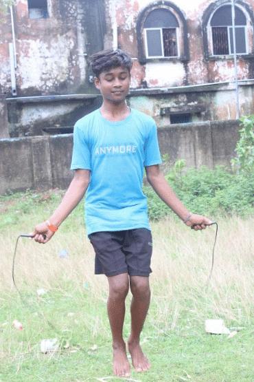"""<div class=""""paragraphs""""><p><em>Sanjay using a skipping rope to exercise.</em></p></div>"""