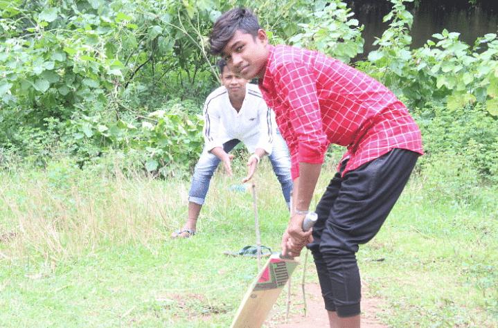 "<div class=""paragraphs""><p><em>Sanjay Munda playing cricket, his favourite sport, at a residential hostel.</em></p></div>"