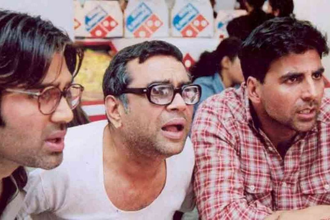 """<div class=""""paragraphs""""><p>Paresh Rawal is known for his role Baburao Apt in <em>Hera Pheri</em>.</p></div>"""
