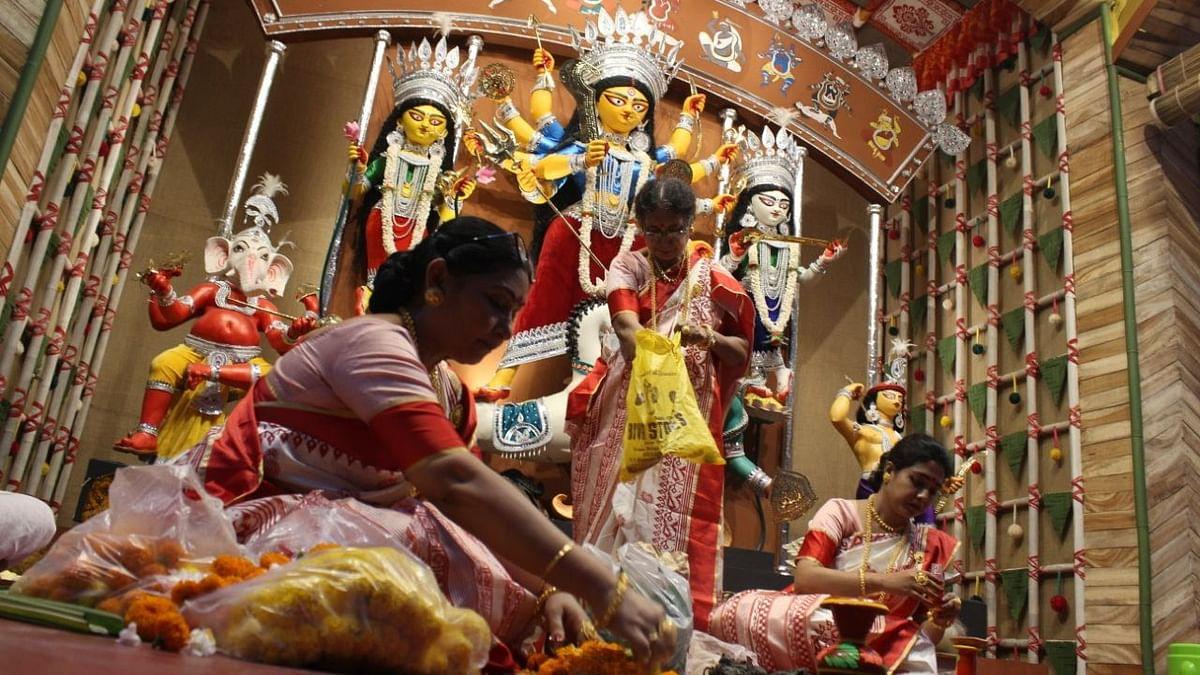"<div class=""paragraphs""><p>Subhamastu prepares for a ritual at the 66 Pally Durga Puja.</p></div>"