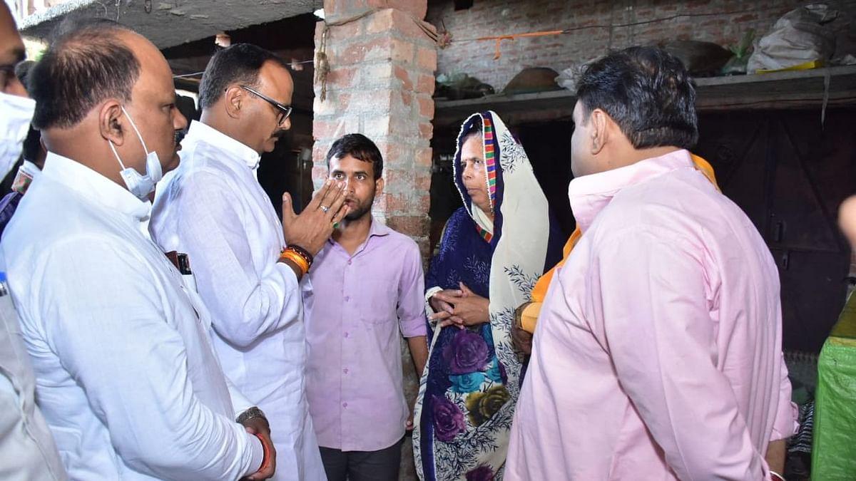"""<div class=""""paragraphs""""><p>Uttar Pradesh Minister Brajesh Pathak on Wednesday, 13 October, with Hari Om's family.</p></div>"""