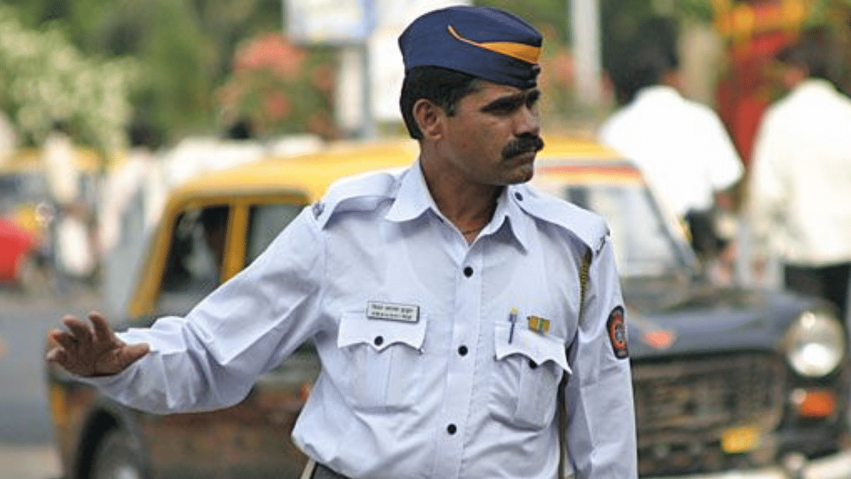 """<div class=""""paragraphs""""><p>Representational Image. Man kidnaps traffic police officer after being stopped for checking.</p></div>"""