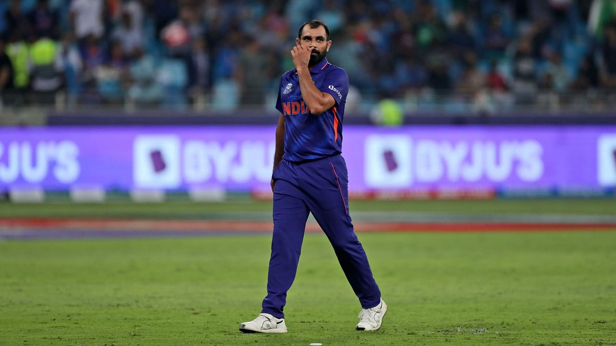 """<div class=""""paragraphs""""><p>India's Mohammad Shami reacts after he was hit for three consecutive boundaries during the Twenty20 World Cup match against Pakistan in Dubai on Sunday, 24 October.<br></p></div>"""
