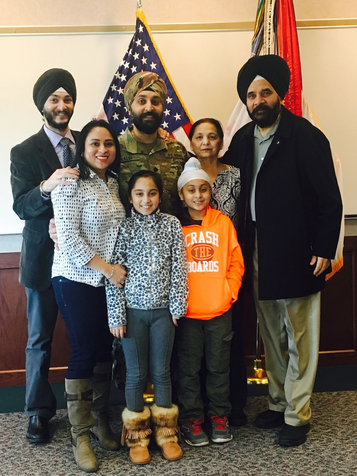 """<div class=""""paragraphs""""><p>Lt Col Kalsi with his family.</p></div>"""