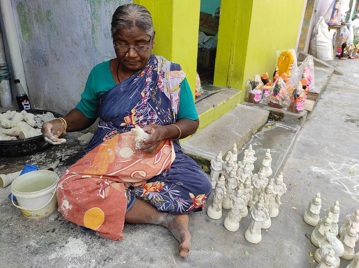 "<div class=""paragraphs""><p>Santhi, a traditional Golu doll artisan, at work at Asthagiri Street.</p></div>"