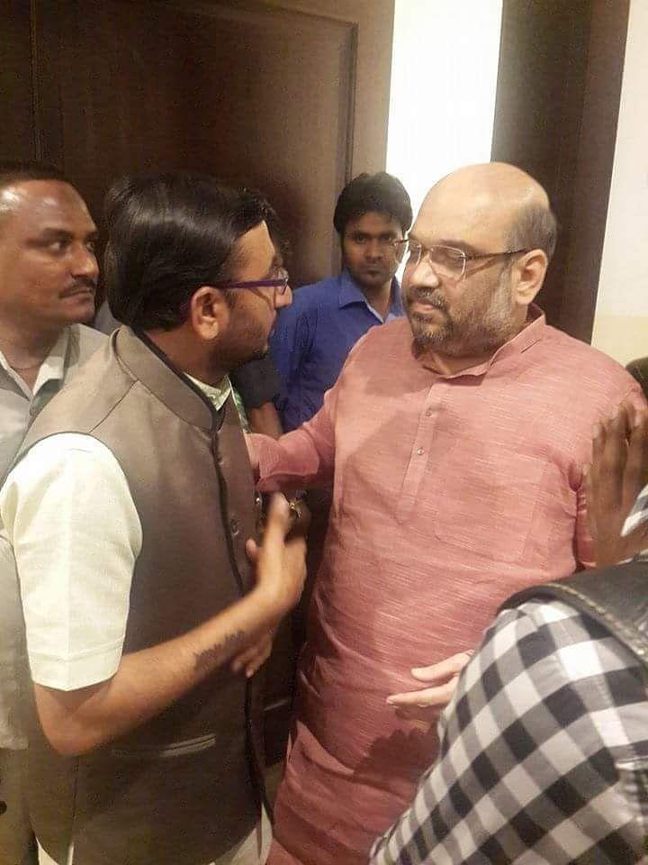 "<div class=""paragraphs""><p>Malik shared photos of Bhanushali with Home Minister Amit Shah.</p></div>"