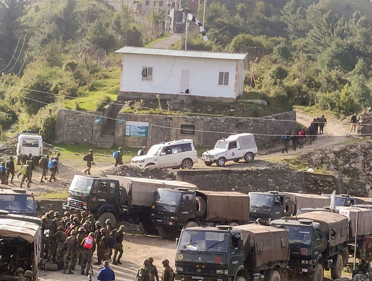 """<div class=""""paragraphs""""><p>Poonch: Security forces stand guard at the encounter site in Surankote area of Poonch district, Monday, 11 October, 2021. Five Army personnel, including a Junior Commissioned Officer (JCO), were killed in a gunfight with terrorists during an anti-insurgency operation in Poonch district of Jammu and Kashmir.<br></p></div>"""