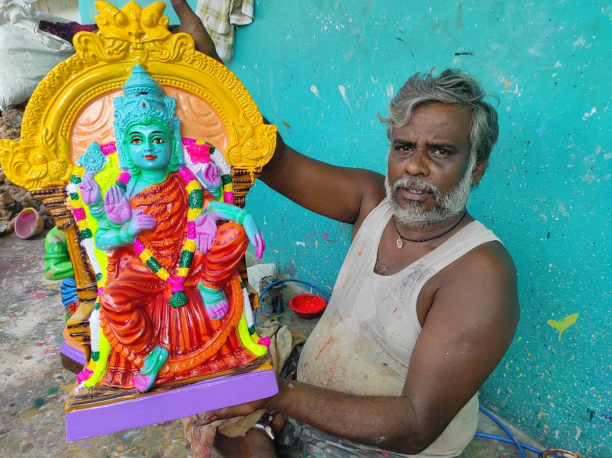 "<div class=""paragraphs""><p>Doll maker Suresh shows his newly introduced doll of goddess<em> Neela Dhakshayini.</em></p></div>"