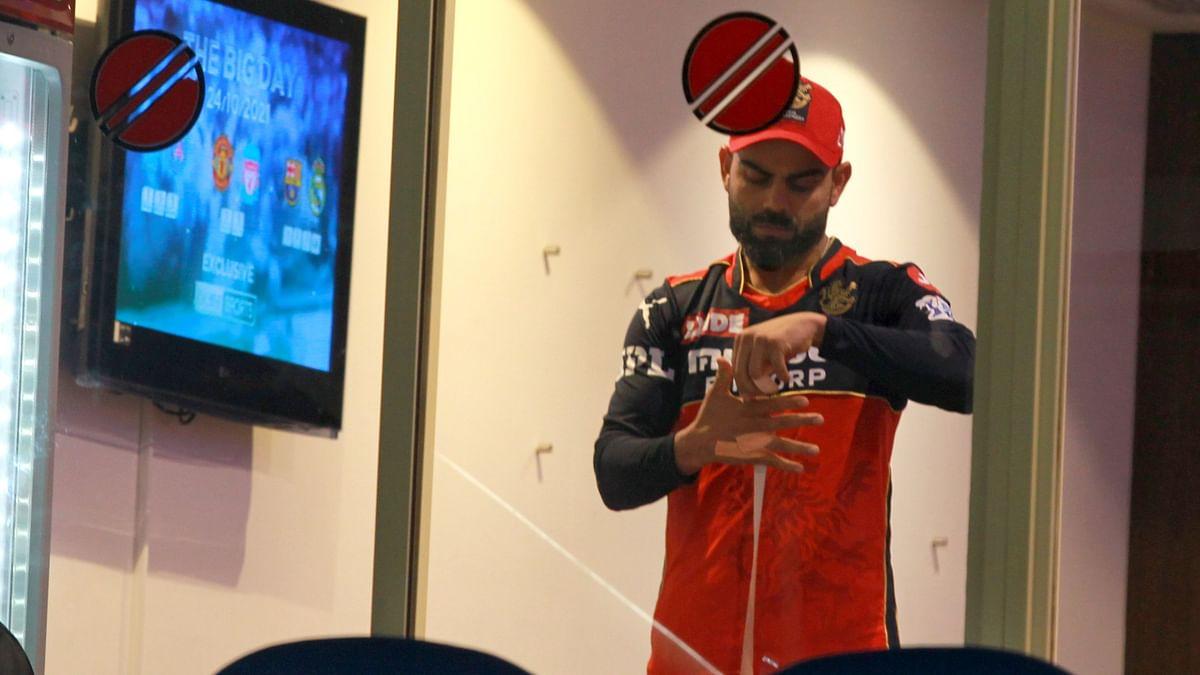 """<div class=""""paragraphs""""><p>Virat Kohli in the dressing room during the innings break.</p></div>"""