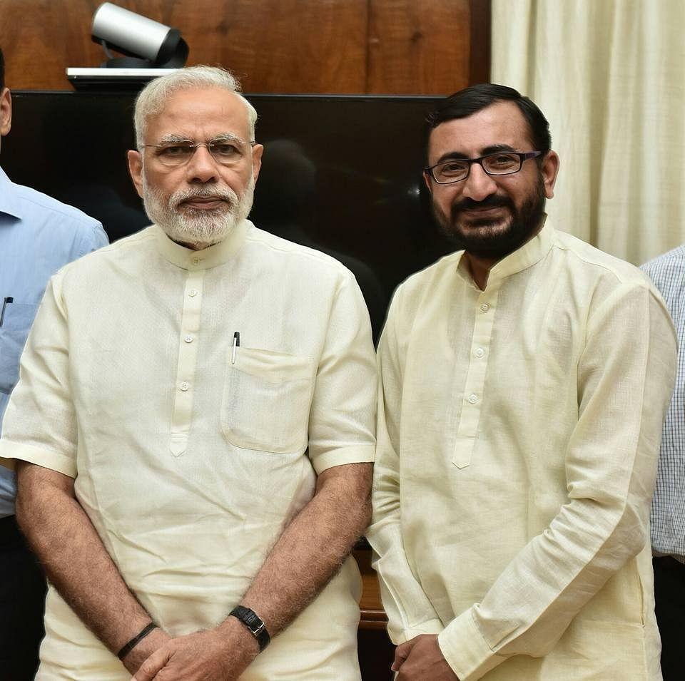 "<div class=""paragraphs""><p>During the presser, Malik shared photos of Bhanushali with PM Narendra Modi.</p></div>"