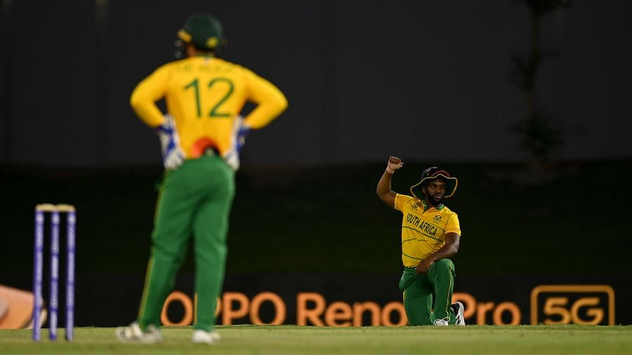 """<div class=""""paragraphs""""><p>Temba Bavuma confirmed at the toss that Quinton de Kock is not in the playing XI for the game against WI in 2021 T20 World Cup</p></div>"""
