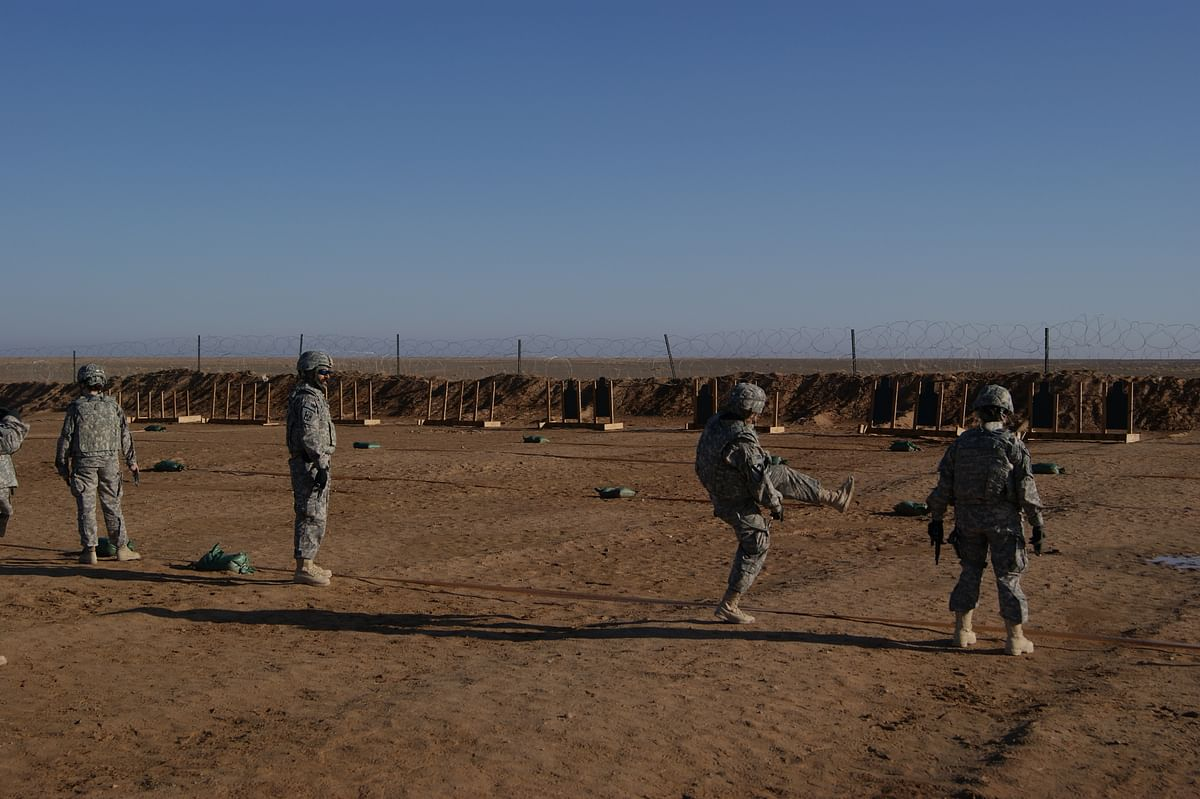 """<div class=""""paragraphs""""><p>Lt Col Kalsi with US Marines at Camp Dwyer in Helmand province in Afghanistan.</p></div>"""