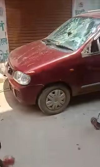 """<div class=""""paragraphs""""><p>The red hatchback, being damaged.</p></div>"""