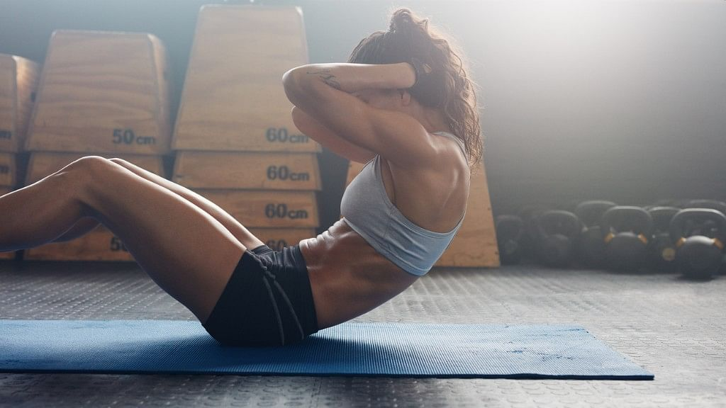 Want to Lose Weight, Have a Flat Tummy? Sit-Ups Aren't the Answer