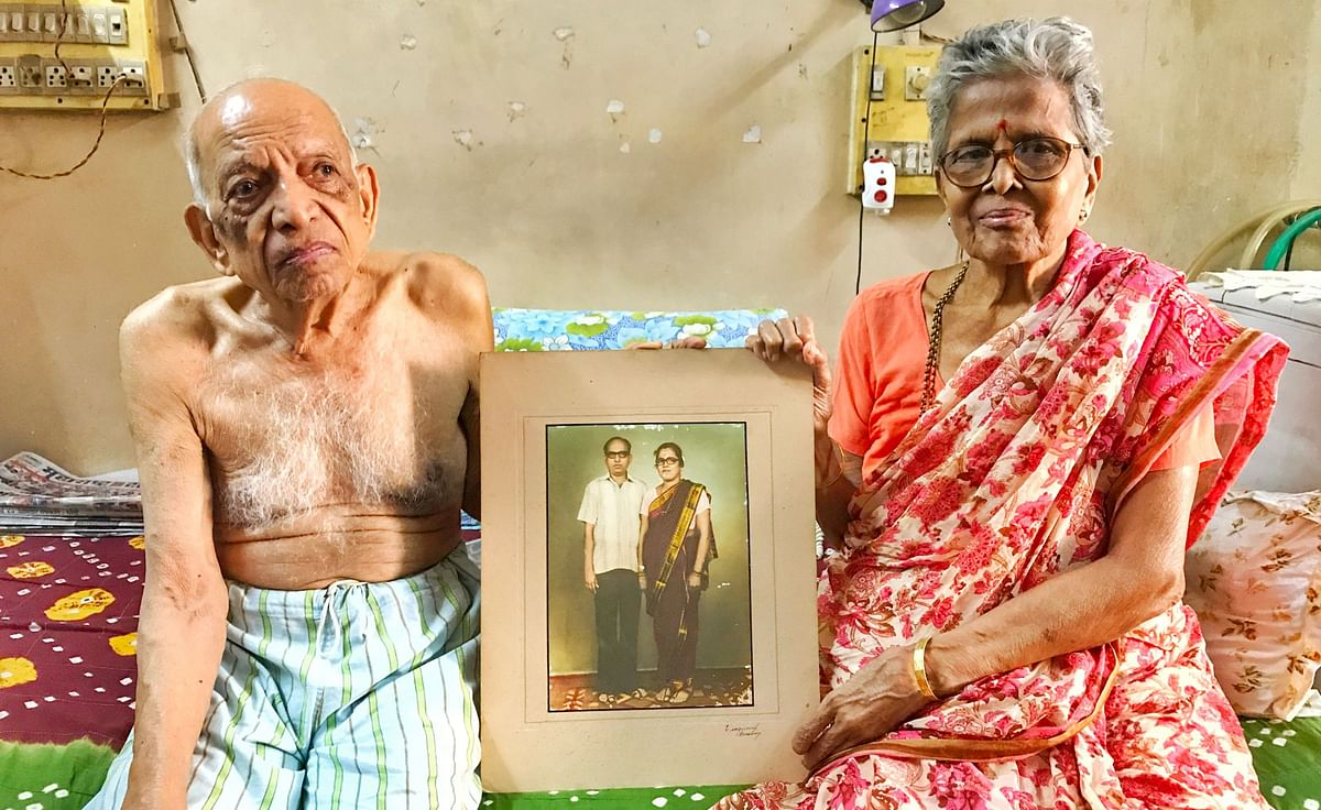 Narayan and Iravati Lavate with an old picture of them from their early days of marriage.