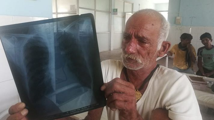 """Mangal Lal, 70, a farmer from Achalpura village, Chittorgarh, Rajasthan suffers from COPD. Lal was a beedi smoker all his life but quit three years ago. """"I cook my own food on the <em>chulha</em>,"""" he says."""