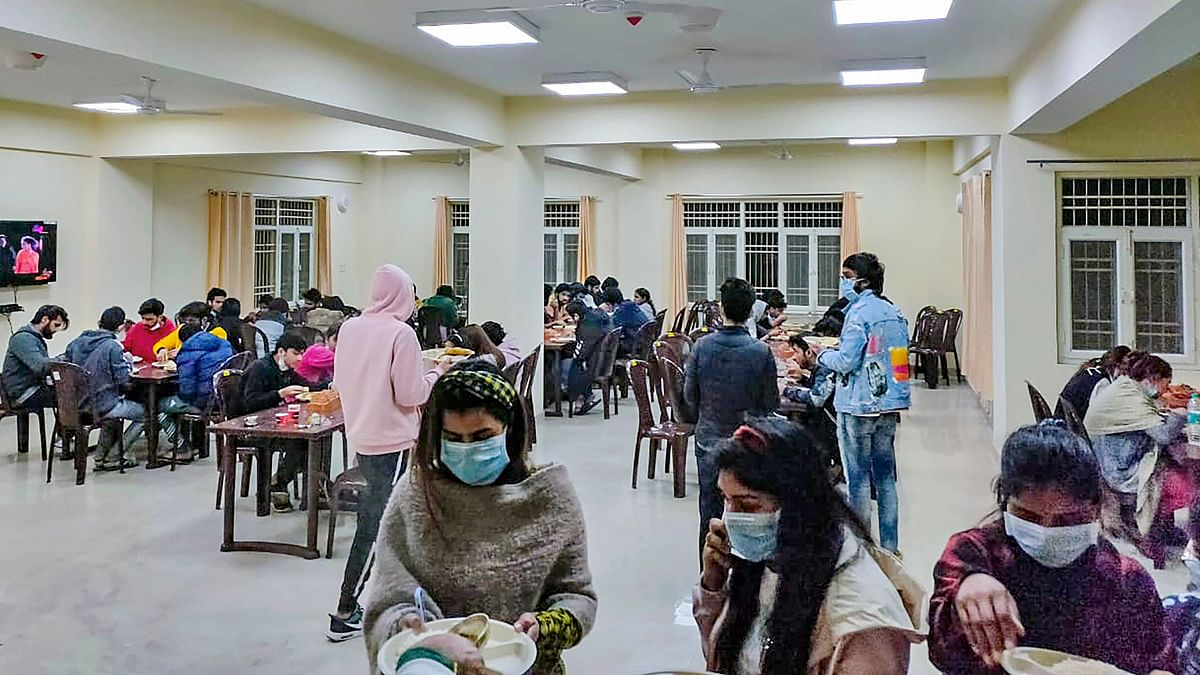 Indian nationals, who were airlifted from coronavirus-hit Wuhan city of Chinas Hubei province, have meal inside a quarantine facility set by up ITBP, in New Delhi
