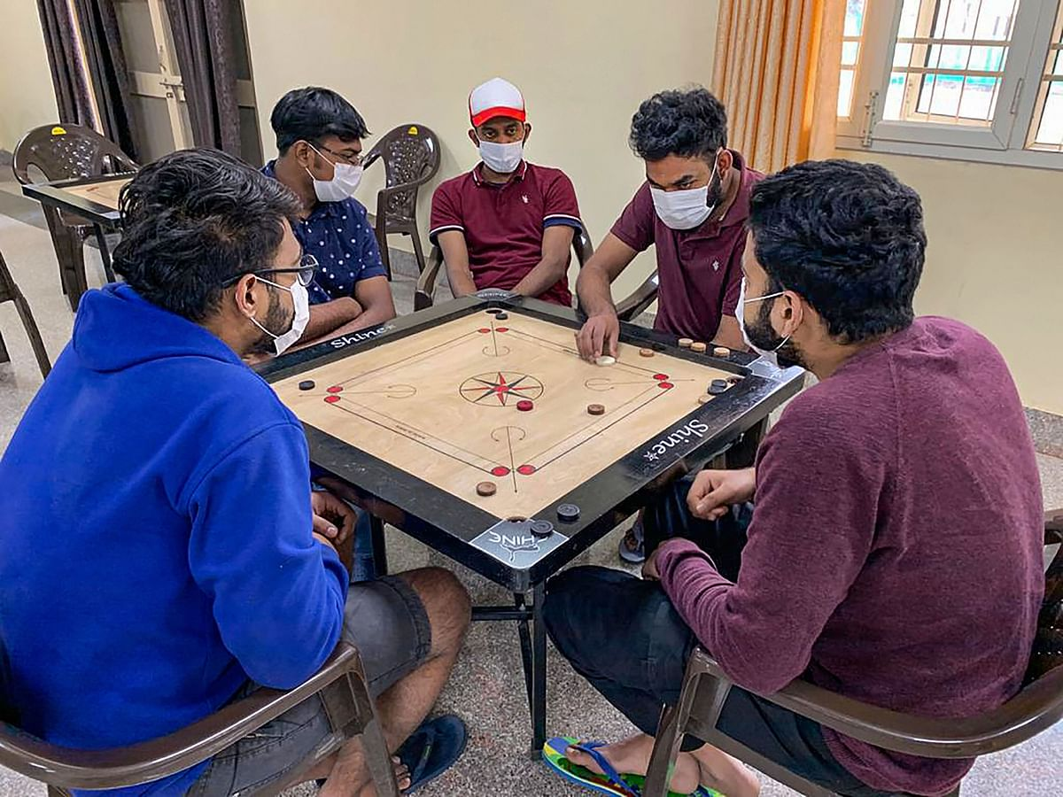 In this handout photo provided by Indo-Tibetan Border Police (ITBP), Indian nationals who were airlifted from coronavirus-hit Hubei province of Chinas Wuhan, play carrom inside a quarantine facility set by up ITBP, at Chhawla area of New Delhi, Sunday, Feb. 9, 2020. As many as 647 Indians have been evacuated through two special Air India flights amid reports of more than 900 people being killed due to the virus in China