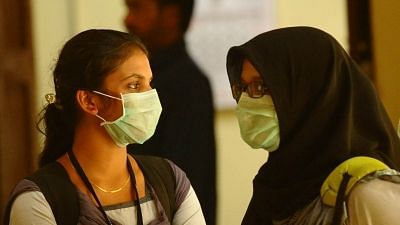 Students wear safety masks as a precautionary measure