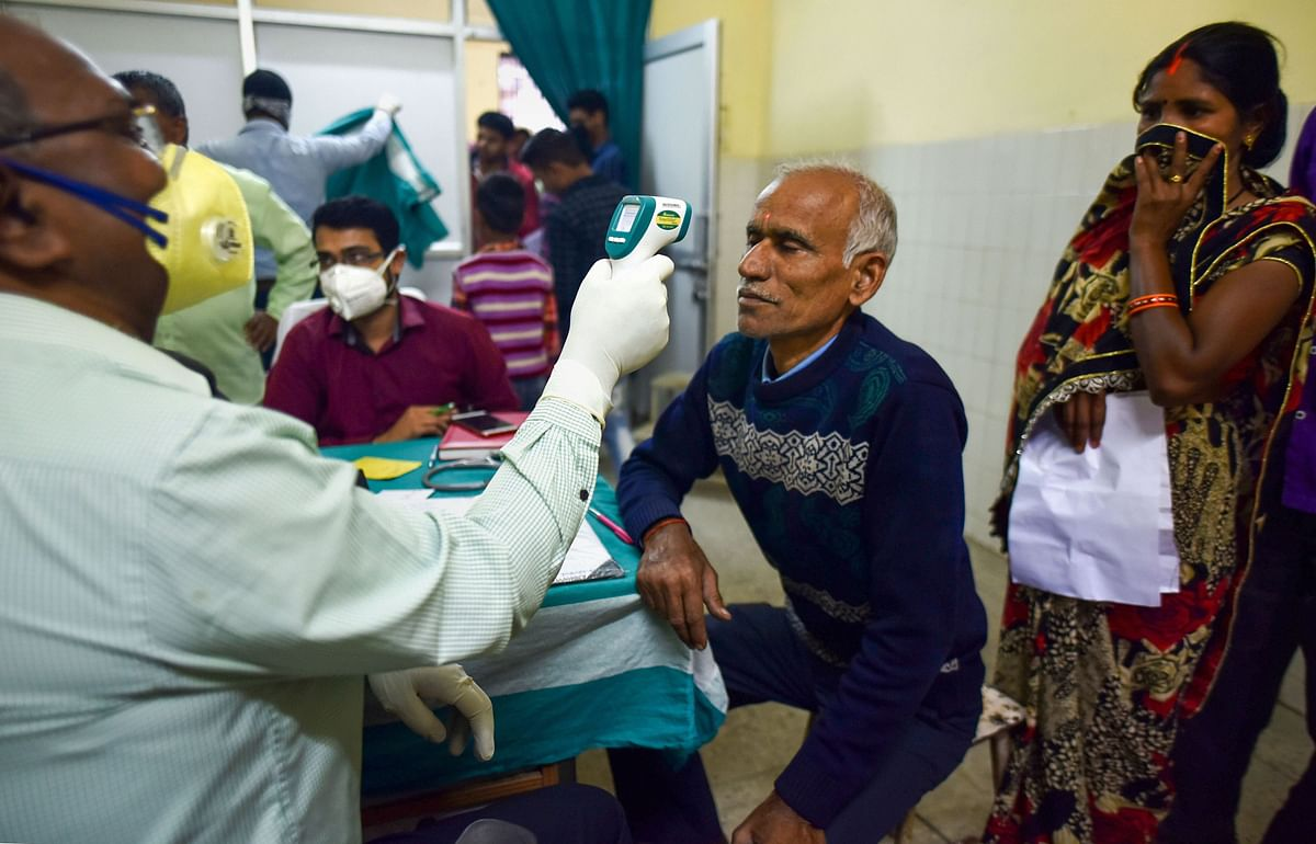 A medic conducts screening of a patient in the wake for novel coronavirus (COVID-19) outbreak, at an OPD of a hospital in Prayagraj (Allahabad), Tuesday, March 17, 2020.