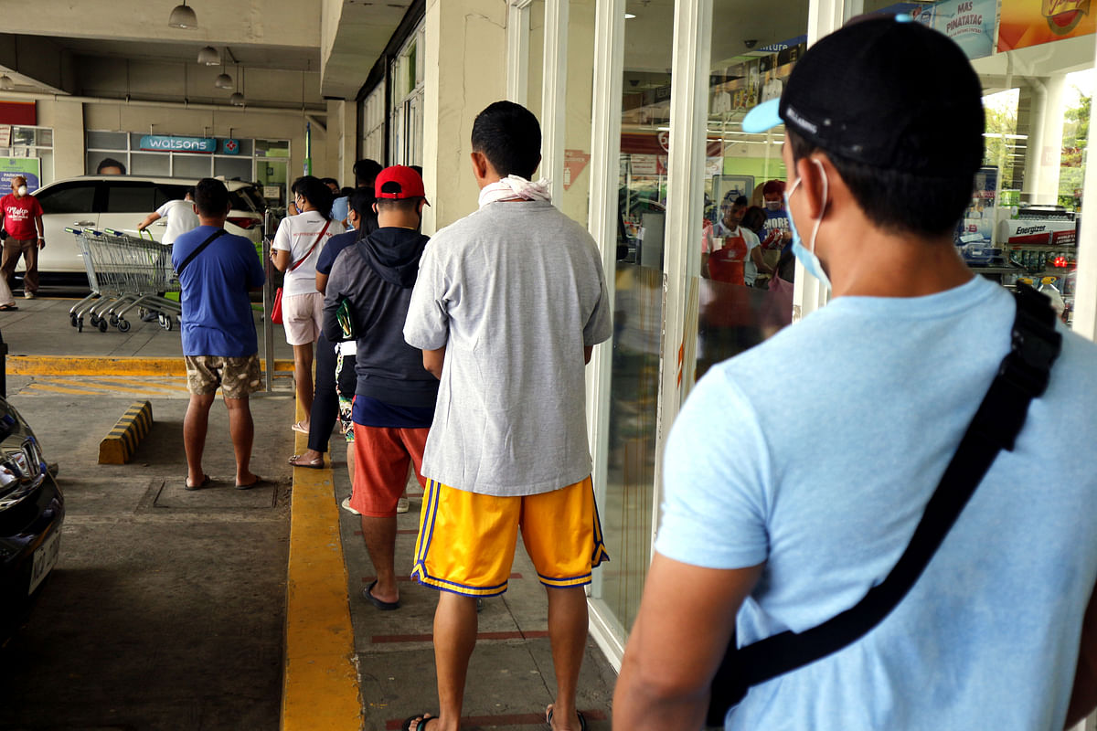 Customers line up with distance outside a store for social distancing on the COVID-19 virus outbreak.