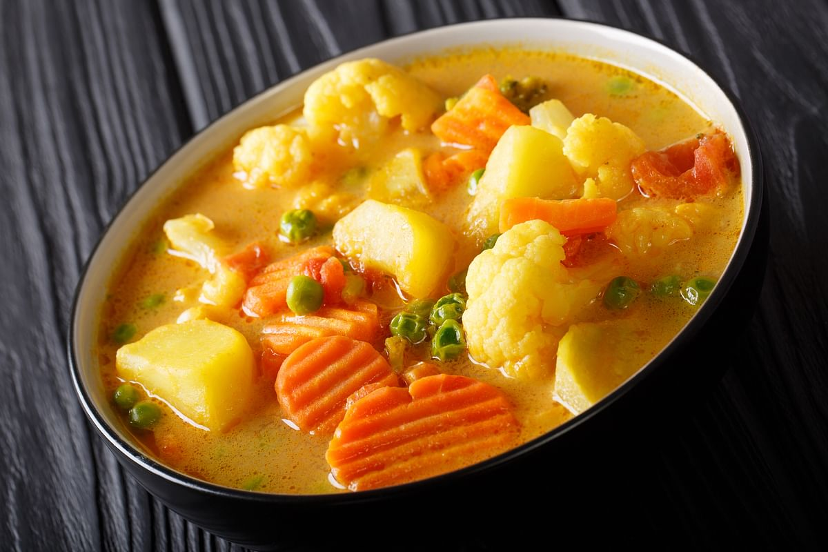 Add vegetables to the curry if you like.
