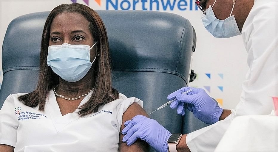 Nurse Sandra Lindsay receives the first Pfizer COVID-19 vaccine in New York on Monday, December 14, 2020, from Dr Michelle Chester.