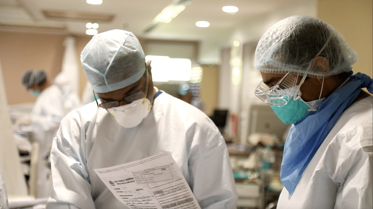 """<div class=""""paragraphs""""><p>Dr Sumit Ray pours over the chart of a 31-year-old patient with his team.&nbsp;</p></div>"""
