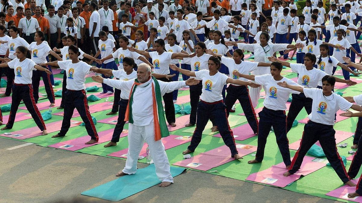 """<div class=""""paragraphs""""><p>Prime Minister Narendra Modi performs yoga along with thousands of others at a mass yoga session to mark the International Day of Yoga 2015. </p></div>"""