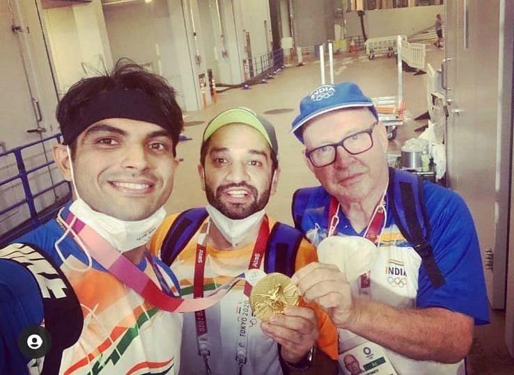 "<div class=""paragraphs""><p>Neeraj Chopra, Ishaan Marwaha, and Chopra's coach, Klaus Bartonietz after his big Olympic win.</p></div>"
